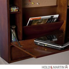 For those with space constraints, this laptop desk from Holly & Martin mounts right to your wall and folds up when you don't need it. The storage area features a tackboard, shelving, paperwork organiz