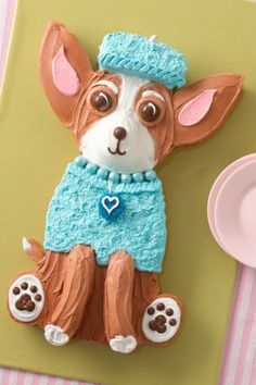 This little pup is as delicious as he is stylish! The printable template makes cutting and assembly a breeze. No worries if the cake isn't cut perfectly, either; just smooth out any not-so-perfect parts with extra frosting.