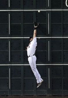 HOUSTON, TX - MAY 02:  J.D. Martinez #14 of the Houston Astros leaps but can't make a catch on a fly ball by Ruben Tejada #11 of the New York Mets in the first inning on May 2, 2012 at Minute Maid Park in Houston, Texas.  (Photo by Bob Levey/Getty Images) game 25