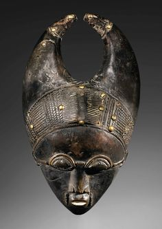 Africa | 'Mblo' mask from the Baule people of the Ivory Coast. | Wood an metal | ca. prior to 1975