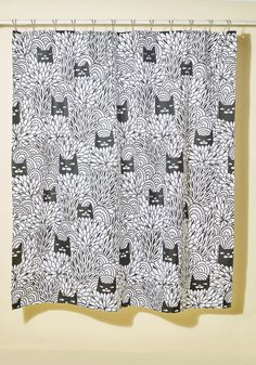 Some Purrs and Quiet Shower Curtain. You'll find yourself in contented repose when you close this printed shower curtain for a relaxing bath. Lulled by a soothing black print of feline faces peeking out from various bushes and brambles, this quirky cloth curtain is a tranquil companion that constantly encourages mellow mornings.