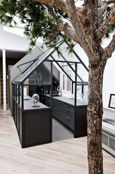 A mini greenhouse kitchen! // Images by Morten Holtum via Daily Dream Decor