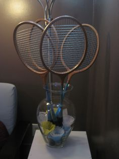 Make a bouquet out of badminton racquets and birdies.