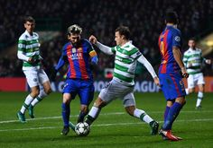 Lionel Messi of Barcelona (L) is tackled by Tomas Rogic of Celtic (C) during the UEFA Champions League Group C match between Celtic FC and FC Barcelona at Celtic Park Stadium on November 23, 2016 in Glasgow, Scotland.