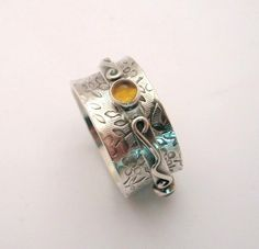 Sterling Silver Spinner Ring with Gemstones - Little Twiddle I by KBerlinMetalsmith on Etsy https://www.etsy.com/listing/60486789/sterling-silver-spinner-ring-with