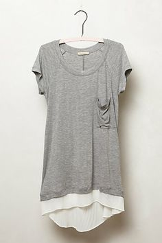 Lace Divide Tee - Anthropologie $58 I like this fancy tee because of its length, the hi-lo on-trend hem and its layered look.  I would pair this with a pair of faux leather pants or leggings and some edgier jewelery.
