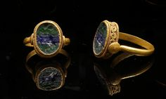 Ancient Roman banded glass ring, dated to the 2nd century CE.