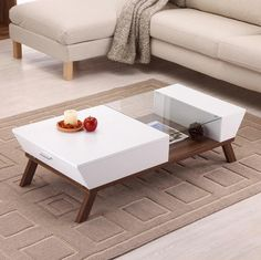 The original layout of the table in brighter tones. On the sides are drawers that gives space for small items. For a note of urban style is charged glass in the middle.