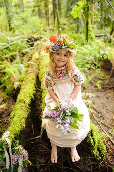 A #stunning #bohemian #flowergirl picks a mossy spot in the woods.