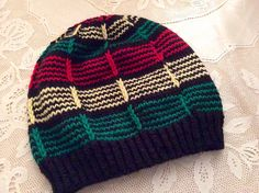 Ravelry: Say It With Color pattern by Galzanne Knits.  Easy, easy, easy pattern to knit.  I used three colors: black, cranberry, and heather gray.  It is for a little boy, so the cast on stitches were reduced to 72.  Here is my finished product:  http://www.ravelry.com/projects/knitforfood/say-it-with-color
