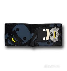 mal wallet with plenty of space for cards and IDs, a see through sleeve for important stuff, and the typical bi-fold format! Whats this on the other side of the Batman Funko Bi-Fold Wallet? OH MY...it is a super cutely deformed version of the Dark Knight! Theres tremendous pressure building up in my head....*POP*! Hey, we are going to need another writer in here!