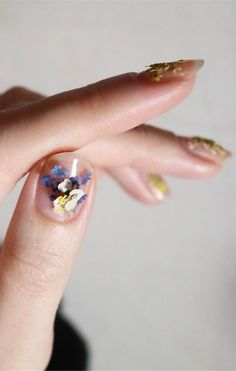 *.* This nail art trend will be everywhere this spring. We're obsessed with these floral nail art looks...