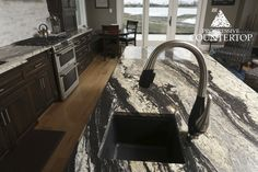 Image result for supreme granite with dark cabinets