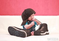 Cute picture idea with daddies shoes for boy (: if I had a girl I would so do this with high heels and lipstick