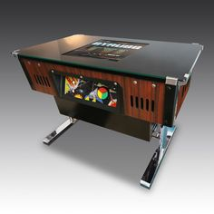 adding asplash if retro and fun for everyone with this retro conversion arcade cocktail table Arcade Table, Luxury Gifts For Men, Arcade Machine, Cocktail Tables, Poker Table, Arcade Games, Game Room, Retro Vintage, Family Room