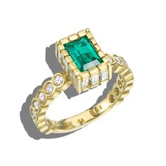 18k yellow gold emerald and diamond ring with .98 ct emerald, and 1.67 ct total weight in round and baguette shaped diamonds #emeraldring #emerald