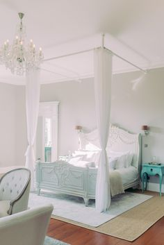 Buckingham Suite at the Thicket Priory, best wedding venue near York and Newcastle Upon Tyne. Light bright and airy bridal preparation room with large french antique bed. In photo is French Bedroom Company Bonaparte bed with tulle drapes and french antique seats. Photo by Cristina Ilao www.cristinailao.com