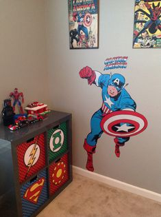 My sons super hero bedroom, homemade backboard from comic books I found at a yard sale. Bedding from bed bath beyond, pillows from Disney outlet store. Also, homemade storage bins. By KatieGillespie.com