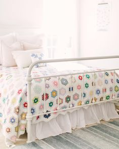 Grandmothers Flower Garden quilt, lots of white, so pretty.