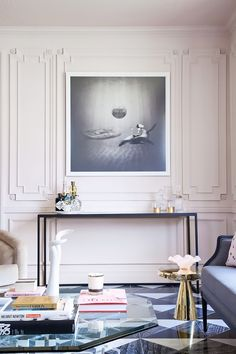 Living space with large art and a well-styled coffee table