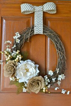 Welcome Fall with this simple, but pretty Fall wreath with burlap flowers!