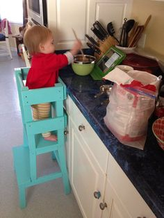 A kids activity tower that secures them while trying to help you cook! Great idea for the little ones so they don't fall off the chair or stool while trying to help in the kitchen!