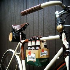 How great is this! A leather strap that holds a six pack to your bike.  Great for heading to a picnic or the beach when your basket is too full!