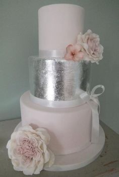 pale pink rose wedding cake ~ the middle tier is covered in silver edible leaf