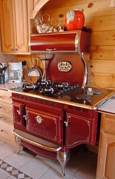 Awesome vintage-style stove.   WOW!! Love the red.