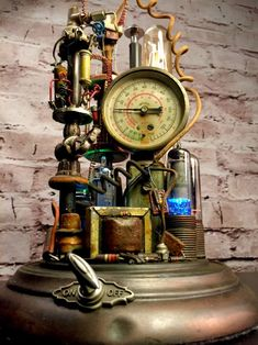 Steampunk Lamp Art Sculpture: Beautiful and interesting details are safely stored under glass. Great details in a lighted space, incredible ambiance in the Lampe Steampunk, Steampunk Gadgets, Steampunk Crafts, Steampunk Design, Rustic Lighting, Vintage Lighting, Lighting Design, Steampunk Furniture, Steampunk Interior