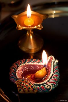 """A diya (oil lamp) lit for Lakshmi puja (prayer) during the Hindu Diwali festival."" Photograph by Katherine Shah on 500px"