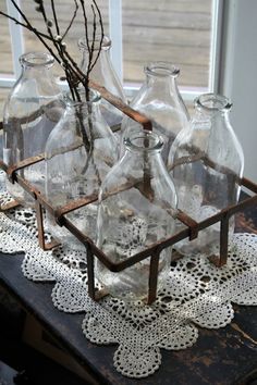 Vintage Milk Bottles.  It would be cool to get milk delivered like this daily.  Seeing as I was not born in the time of home delivery milk, these little bottles would make a great centerpiece or garden accent.