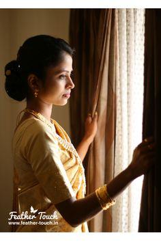Adorable bride in golden saree.