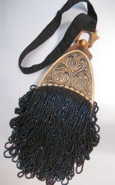 Art Nouveau Decorative Floral Plastic Clasp Wristlet Purse Black Irridescent Hand Beaded Handbag. $365.00, via Etsy. #vintage #purses
