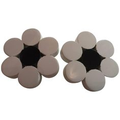 1980s JUDITH HENDLER White with Black Center Flower Clip On Earrings | From a unique collection of vintage clip-on earrings at https://www.1stdibs.com/jewelry/earrings/clip-on-earrings/
