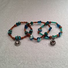 Beaded bracelets with flat pansy and Czech Firepolish beads and drop diamonds on Etsy, $22.00