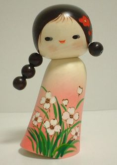 girly little kokeshi doll with interesting hair