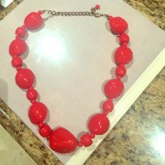 Red beaded stone-like necklace Excellent condition. Rarely worn. Jewelry Necklaces