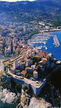 The view of Calvi Harbor ~ is located on the northwest coast of the Island of Corsica in France.