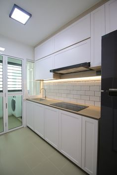 Scandinavian project @ Compassvale Crescent. Scandinavian kitchen concept with Kompacplus kitchen top and white subway tiles.   http://www.unityid.sg/portfolio/Scandinavian-Compassvale-Boardwalk-66/642  samuel@unityid.sg