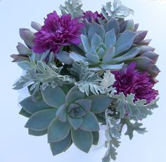 Succulent & purple flower wedding bouquet.  I would love to include succulents in my bouquet somehow!
