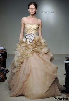 New York Bridal Week - Vera Wang, intricate Degas-inspired designs, artful pleats, oversized tulle bows, corset bodices
