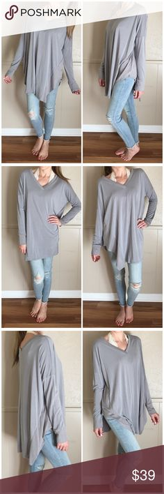 """▫️Softest Dove Grey Modal Basic Long Sleeve I am LOVING these tees! This is a must have! Oversized grey long sleeve in amazingly soft modal fabric. Sleeves are nice and long, v neck in front and back, slits in sides, just perfect! Easy to layer or wear along. Love the length. Also available in ivory.  Modeling small. 73% modal 27% polyester. Made in USA.  Bust: (S) 24"""" (M) 25"""" (L) 26"""" Length: (S) 30"""" (M) 31"""" (L) 32"""" *Bundle 2+ items for discount. Tops Tees - Long Sleeve"""