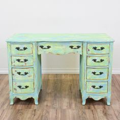 This 8 drawer kneehole desk is shabby chic at its finest. Featuring a blue and green painted finish, this small desk provides lots of storage in a small footprint. Made by Bassett Furniture. #shabbychic #desks #kneeholedesk #sandiegovintage #vintagefurniture