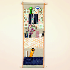 quilting happiness pocket wall caddy - can hang out of sight when studio must become dining room, keeps sharp objects out of reach of small children, and point safe from bashing