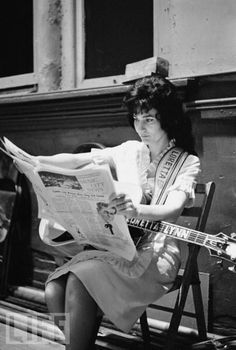 Loretta Lynn participating in one of my favorite activities: reading the paper.