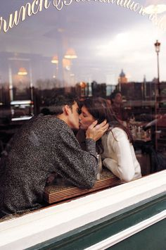 a kiss in a cafe