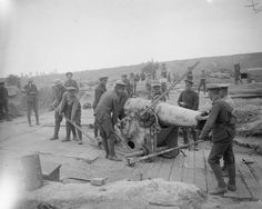 MINISTRY INFORMATION FIRST WORLD WAR OFFICIAL COLLECTION (Q 4412)   British gunners getting a 220mm French howitzer into position. Carnoy Valley, end of July or August 1916.