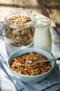 Our delicious homemade granola recipe is a perfect way to start your day with a health kick! Full of nuts and seeds that give you a good helping of protein, heart-healthy fats, essential vitamins, minerals and antioxidants. Enjoy!