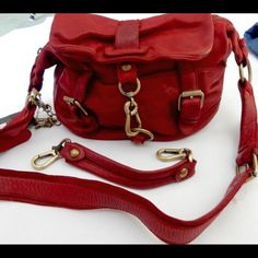 "Rare Italian Leather Bag - Errelleventidue RL22 This fabulously rugged red leather crossbody hobo bag (Style 876) is the epitome of boho chic. NWT, never used, no dust bag. Made in Italy. HTF. NO TRADES/PAYPAL. Features:  Zipper closure w/ lobster claw ring closure Golden brass hardware Interior: Cell phone pocket, zippered pocket Exterior : front slip pocket, additional pocket at back plus a third zippered pocket Lining: Cotton Twill Signature key charms 12"" x 8.5"" x 5.5"" Detachable handle…"